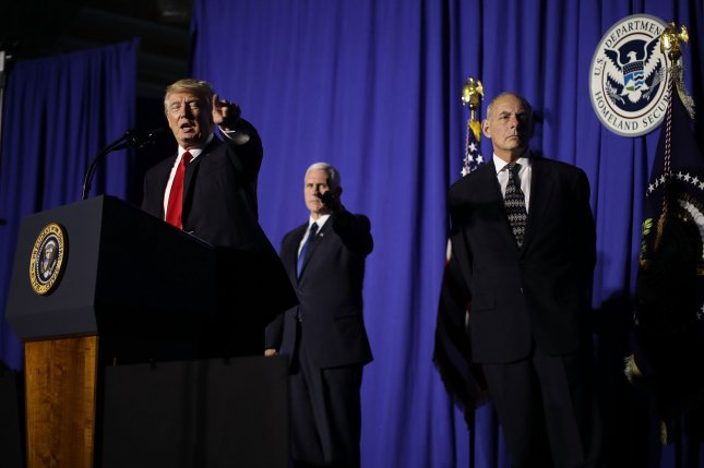 U.S. President Donald Trump, L, delivers remarks during a visit to the Department of Homeland Security with Vice President Mike Pence, C, and Homeland Security Secretary John Kelly on Wednesday in Washington, D.C. On Friday, Trump signed an executive order to temporarily halt admission to the United States by refugees worldwide and citizens of seven Muslim-majority countries. Pool Photo by Chip Somodevilla/UPI
