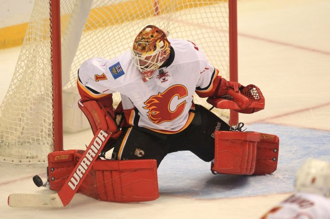 Calgary Flames goaltender Brian Elliott returned from his sick bed to make 24 saves and earn his 10th consecutive win as Calgary posted a 3-1 win. File Photo by Bill Greenblatt/UPI