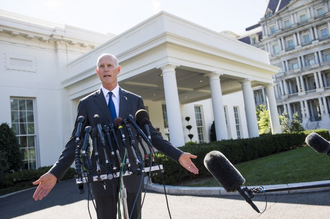 Florida Gov. Rick Scott speaks to reporters following a meeting with President Donald Trump on the government's responses to the recent hurricanes in Washington, D.C., on Friday. Photo by Kevin Dietsch/UPI