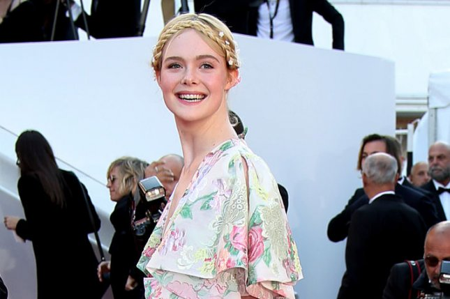 Elle Fanning Blames Tight Dress For Fainting Spell In Cannes