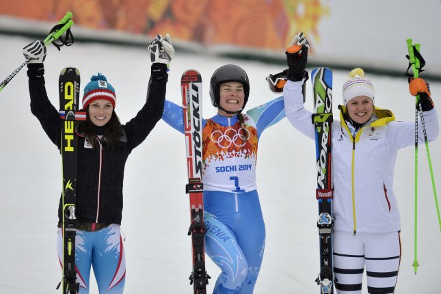 Austria's Anna Fenninger (L-R), Slovenian Tina Maze and Germany's Viktoria Rebensburg celebrate after they won silver, gold and bronze during the ladies' giant slalom at the Sochi 2014 Winter Olympics on February 18, 2014 in Krasnaya Polyana, Russia. Maze finished with a total time of 2:36.87 while Fenninger finished at 2:36.94 and Rebensburg at 2:37.14 for two runs. UPI/Brian Kersey