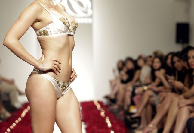 A model walks on the runway at the Rococo Dessous 24 Karat Gold Lingerie runway show at The Metropolitan Suite In New York City on August 2, 2013. (UPI/John Angelillo)