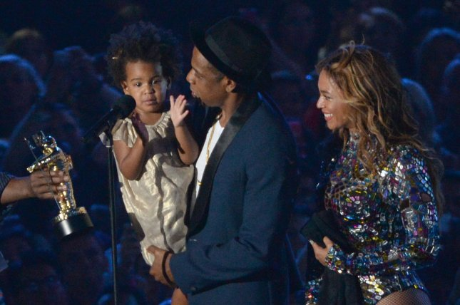 Blue Ivy Carter (L-R), Jay Z and Beyonce accept the Video Vanguard Award at the 2014 MTV Video Music Awards on August 24, 2014. In a commercial for her new activewear line, Beyonce talks about how Blue Ivy is her inspiration to keep going when she feels like giving up. File Photo by Pat Benic/UPI