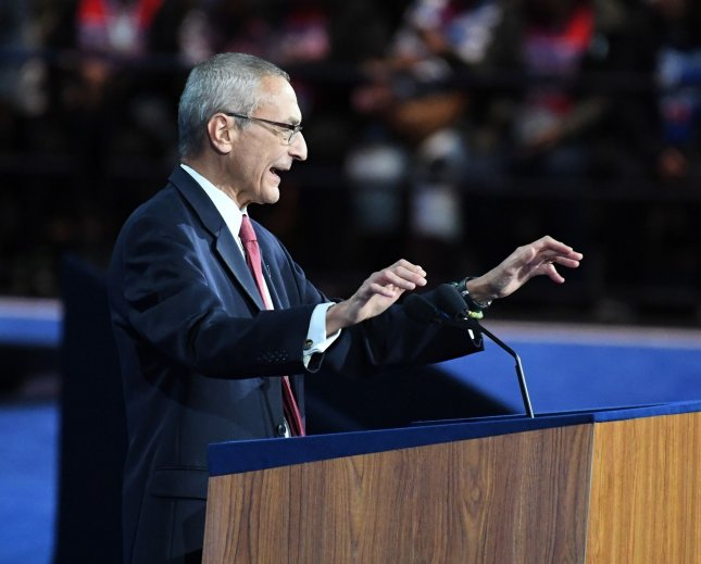 John Podesta, chairman of the Hillary Clinton's presidential campaign, spoke Tuesday at the rally at the Javits Center in New York. In a conference call Thursday he blamed the late-campaign actions of FBI Director James Comey for Clinton's loss, but others on the call had other reasons for the defeat. Photo by Pat Benic/UPI