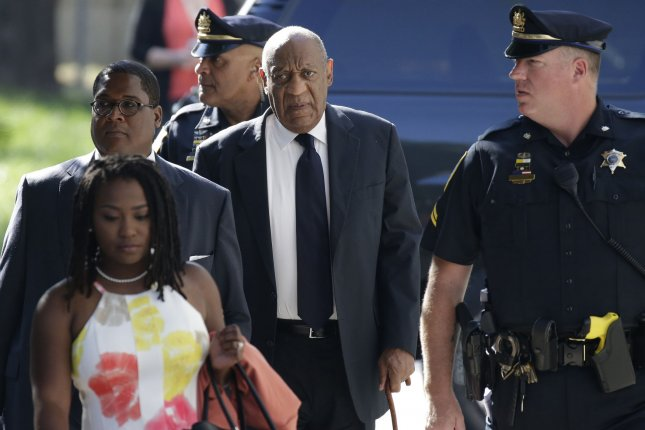 Bill Cosby (C) arrives at Montgomery County Courthouse on Tuesday for Day 2 of deliberations in his sexual assault trial in Norristown Pa. Deliberations began in Cosby's trial on charges of aggravated indecent assault on Monday night after prosecutors and defense attorneys made their final pleas to the jury. Photo by John Angelillo/UPI