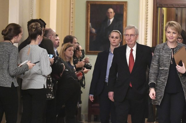 Senate Republican leader Mitch McConnell of Kentucky departs the Senate floor at the U.S. Capitol on Thursday. The Senate failed to pass two competing bills, a Republican proposal of $5.7 billion to fund President Trump's border wall and a Democratic bill to re-open the partially shut down government. Photo by Mike Theiler