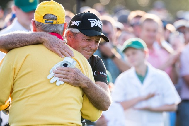 Golf legends Gary Player (R) and Jack Nicklaus won a combined nine Green Jackets during their decorated playing careers. Photo by Kevin Dietsch/UPI