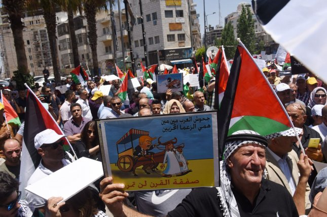Palestinians rally Monday against a proposed U.S. peace deal in Ramallah, West Bank. Photo by Debbie Hill/UPI