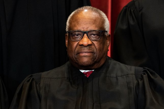 Associate U.S. Supreme Court Justice Clarence Thomas, shown during an April 23 photo session, wrote the majority opinion in Caniglia vs. Strom. File photo by Erin Schaff/UPI/Pool