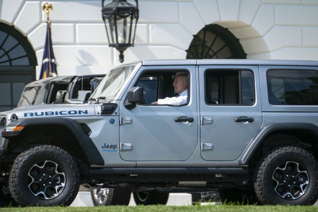 President Joe Biden drives a Jeep Wrangler Unlimited 4xe Rubicon around the White House grounds during an event on electric vehicles on the South Lawn of the White House in Washington, D.C., on Thursday. Photo by Sarah Silbiger/UPI