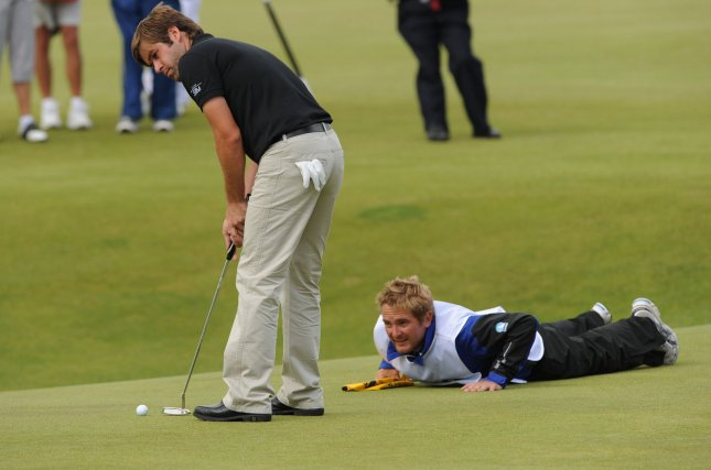 Englishman Robert Rock putts on the 18th green on the third day of the Open championship in St.Andrews, Scotland on July 17, 2010. UPI/Hugo Philpott