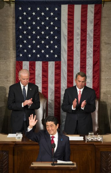 Japanese Prime Minister Shinzo Abe, flanked by by Vice President Joseph Biden (L) and House Speaker John Boehner (R), waves as he begins his speech to a joint session of the United State Congress in the House chamber of the U.S. Capitol on April 29, 2015 in Washington, DC. Abe became the first Japanese Prime Minister to address a joint meeting of Congress. Photo by Pat Benic/UPI