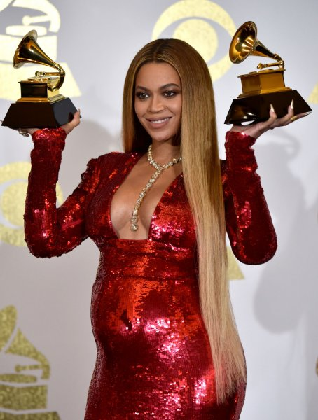 Beyonce appears backstage with her awards for Best Music Video for Formation and Best Urban Contemporary Album for Lemonade during the 59th annual Grammy Awards held at Staples Center in Los Angeles on February 12. The pregnant singer has dropped out of the Coachella Music Festival. Photo by Christine Chew/UPI