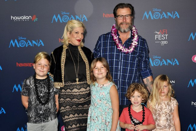 Tori Spelling (L) with husband Dean McDermott and their children (L-R) Liam, Stella, Finn and Hattie at the Los Angeles premiere of Moana on November 14. Spelling shared on social media a new photo of her newborn son Beau. File Photo by Christine Chew/UPI