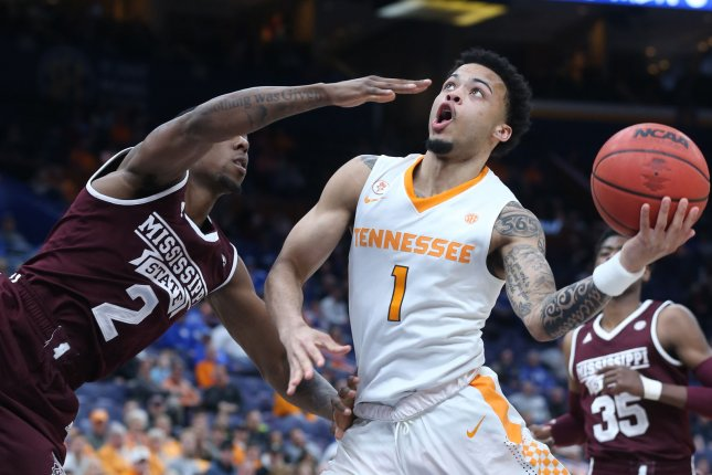Tennessee's Lamonte Turner gets past Mississippi State's Eli Wright, taking a off balance shot in the first half of their the SEC Tournament game against Georgia on March 9 at the Scottrade Center in St. Louis, Mo. Photo by BIll Greenblatt/UPI
