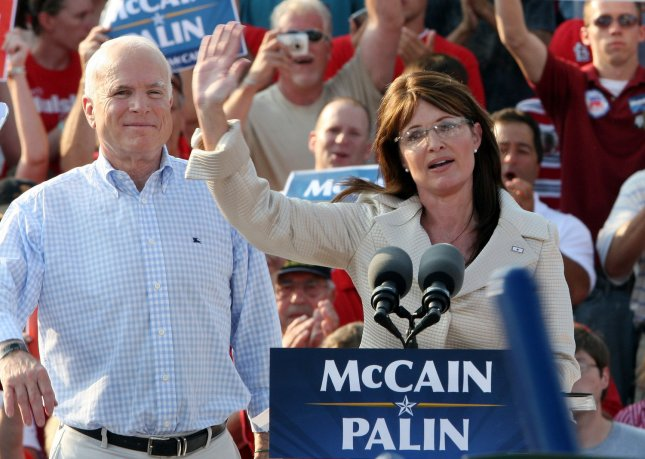 Vice Presidential candidate Gov. Sarah Palin waves to the crowd while running mate Presidential candidate Sen. John McCain stands near, during a rally at the T.R. Hughes Ballpark in O'Fallon, Missouri on August 31, 2008. (UPI Photo/Bill Greenblatt)