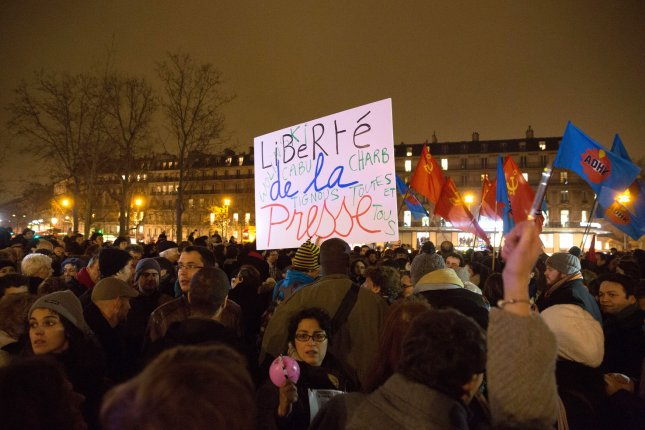French people rally at one of Paris' main squares in a display of solidarity after the terrorist attack at Charlie Hebdo weekly newspaper in Paris on January 7, 2015. In France's deadliest postwar terrorist attack, 2 policemen and 10 journalists died after terrorists stormed and open fired during an editorial conference. Photo by Eco Clement/UPI