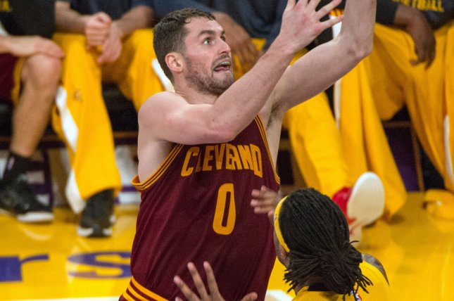 Cleveland Cavalier forward Kevin Love (0) scores over Los Angeles Lakers center Jordan Hill (27) during the first half of their NBA game at Staples Center in Los Angeles, January 15, 2015. The Cavaliers defeated the Lakers 109-102. UPI/Jon SooHoo