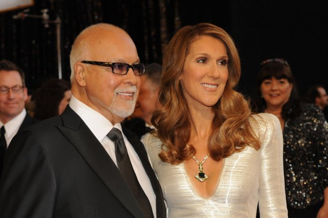 Singer Celine Dion and husband and manager Rene Angelil arrive on the red carpet for the 83rd annual Academy Awards at the Kodak Theater in Hollywood on February 27, 2011. File Photo by UPI/Jim Ruymen