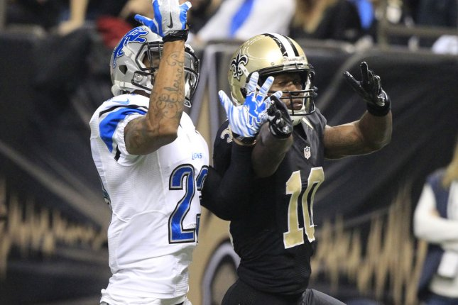 New Orleans Saints wide receiver Brandin Cooks (10) has a Drew Brees pass knocked away by Detroit Lions cornerback Darius Slay (23) during the first quarter at the Mercedes-Benz Superdome in New Orleans December 21, 2015. Photo by AJ Sisco/UPI