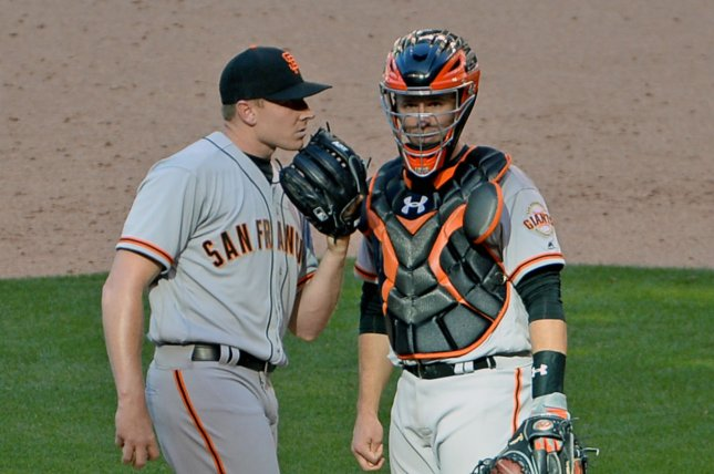 San Francisco Giants pitcher Mark Melancon (L) talks with catcher Buster Posey in the ninth inning. File photo by Art Foxall/UPI