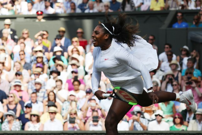 America's Serena Williams returns the ball in her match against Italy's Camila Giorgi in the women's quarterfinals of the 2018 Wimbledon championships on Tuesday in London. Photo by Hugo Philpott/UPI