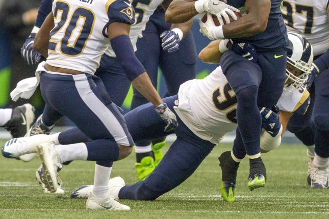 de035425d Seattle Seahawks running back Mike Davis (39) runs for an 11-yard gain  before being tackled by ex-Los Angeles Rams outside linebacker Connor Barwin  (98) ...