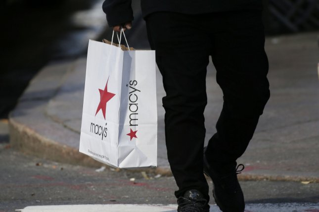 Shoppers hold bags as they walk in Herald Square in New York City on November 27, 2020. New data from the Bureau of Labor Statistics says the core inflation index for 12 months has increased at its fastest rate since 1992. File photo by John Angelillo/UPI
