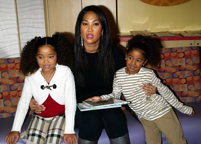 Kimora Lee Simmons and daughters visit sick children in the pediatric unit at St. Vincent's hospital in New York on November 20, 2007. (UPI Photo/Laura Cavanaugh)