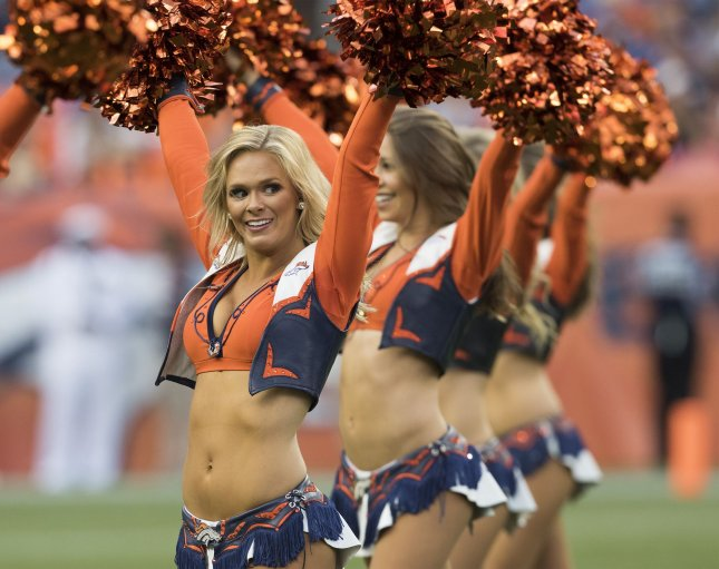 Denver Broncos cheerleaders perform during pre-season game three at Sports Authority Field at Mile High in Denver on August 27, 2016. Photo by Gary C. Caskey/UPI