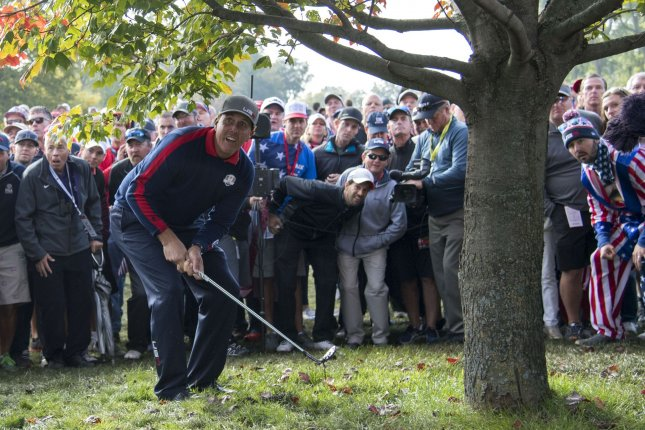 USA team member Phil Mickelson hits from the deep rough on the 10th fairway on day 1 of the 2016 Ryder Cup at Hazeltine National Golf Club in Chaska, Minnesota on September 30, 2016. Photo by Kevin Dietsch/UPI