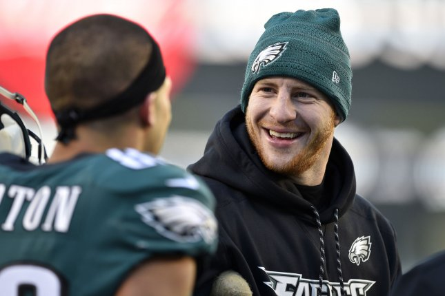 Philadelphia Eagles quarterback Carson Wentz smiles on the sidelines prior to an NFC divisional playoff game against the Atlanta Falcons on January 13 at Lincoln Financial Field in Philadelphia. Photo by Derik Hamilton/UPI