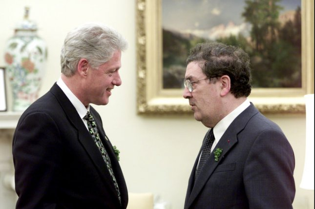 U.S. President Bill Clinton meets meets with Northern Irish lawmaker and Nobel Peace Prize winner John Hume in the Oval Office of the White House on March 17, 2000. File Photo by William Vasta/the White House/UPI