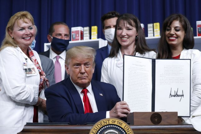 U.S. President Donald Trump on Sunday signed an executive order that replaces the one he signed on lowering drug prices in the Eisenhower Executive Office Building in Washington, D.C., on July 24. Photo by Stefani Reynolds/UPI