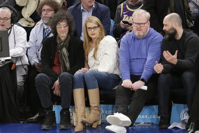 Howard Stern and Beth Ostrosky watch the Los Angeles Lakers play the New York Knicks at Madison Square Garden on January 22 in New York City. The radio show host turns 67 on January 12. File Photo by John Angelillo/UPI