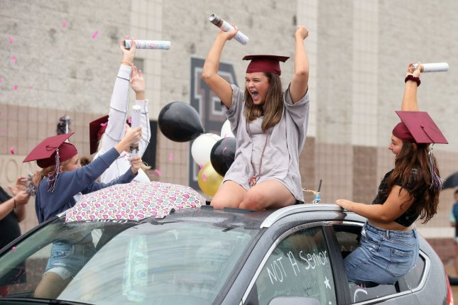 Vaccinating fewer than half of Philadelphia's nearly 23,000 teachers reduced COVID-19 test positivity rates by 95%, potentially preventing the need for drive-by graduations such as the one pictured in 2020, according to the CDC. File Photo by Bill Greenblatt/UPI