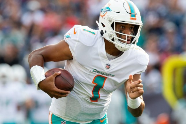 Miami Dolphins quarterback Tua Tagovailoa charges into the end zone for a touchdown against the New England Patriots on Sunday at Gillette Stadium in Foxborough, Mass. Photo by Matthew Healey/UPI