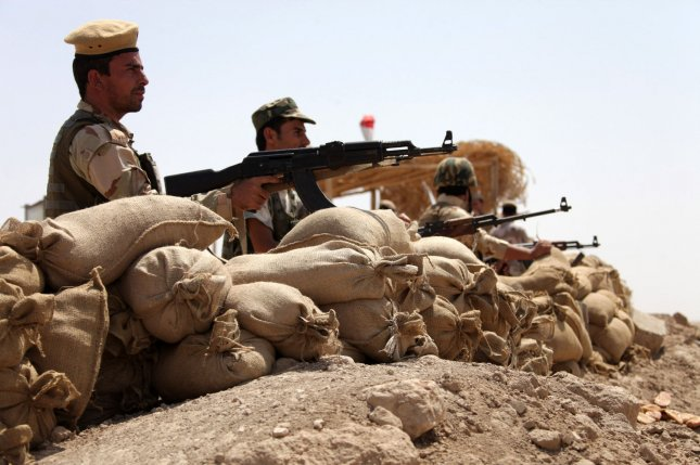 Kurdish Peshmerga soldiers take up position near the town of Makhmur in northern Iraq's Kurdistan region on August 28, 2014. File photo by Mohammed al Jumaily/ UPI