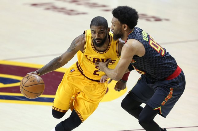 Cleveland Cavaliers' Kyrie Irving (L) drives to the basket while defended by Atlanta Hawks' DeAndre' Bembry during the first half at Quicken Loans Arena in Cleveland on April 7, 2017. File photo by Aaron Josefczyk/UPI