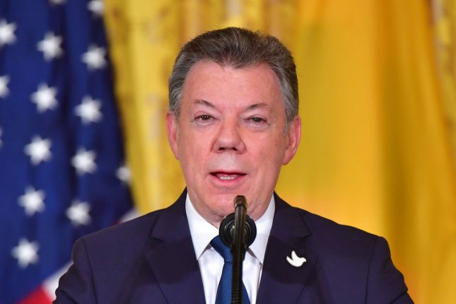 Columbian President Juan Manuel Santos announced Friday that his country has joined the Organization for Economic Cooperation and Development (OECD) and starting next week, will become a global partner of North Atlantic North Atlantic Treaty Organization (NATO). Photo by Kevin Dietsch/UPI