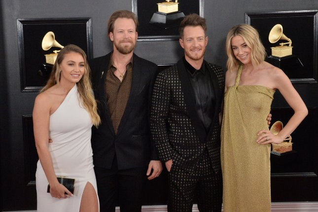 Tyler Hubbard (second from right) and Hayley Hubbard (R), pictured with Brittney Marie Cole (L) and Brian Kelley at the Grammy Awards on Sunday, are having another baby. File Photo by Jim Ruymen/UPI