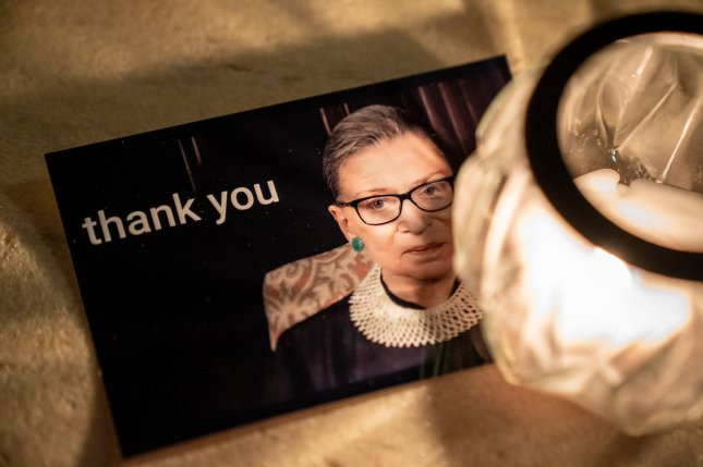 A card thanking Associate Supreme Court Justice Ruth Bader Ginsburg lays on the steps of the United States Supreme Court. Photo by Ken Cedeno/UPI