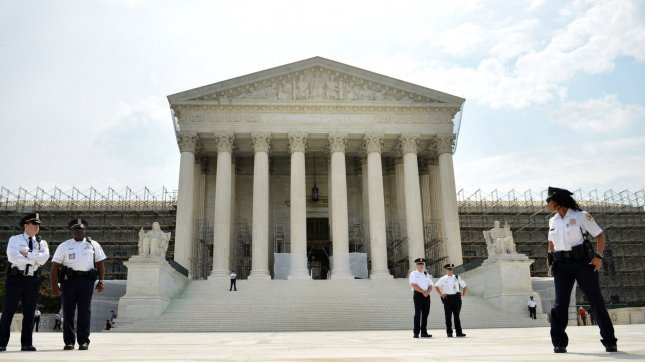 Police stand guard outside of the United State Supreme Court on June 25, 2012 in Washington, D.C. UPI/Kevin Dietsch