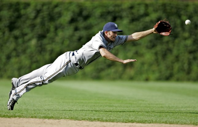 Milwaukee Brewers shortstop J. J. Hardy, sent to the minors Aug. 12, 2009, is shown reaching for a line drive in a Sept. 18, 2008 contest. (UPI Photo/Brian Kersey)