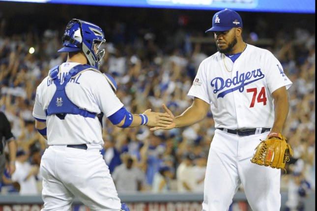 Los Angeles Dodgers' closer Kenly Jansen, right, and catcher A.J. Ellis, congratulate each other after beating the New York Mets in game 2 of the National League Division Series against the at Dodger Stadium in Los Angeles on October 10, 2015. The Dodgers won 5-2. Photo by Lori Shepler/UPI