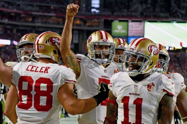 San Francisco's quarterback Colin Kaepernick raises his fist after scoring the game tying touchdown in the fourth quarter of the 49ers-Arizona Cardinals game at University of Phoenix Stadium in Glendale, Arizona, November 13, 2016. Photo by Art Foxall/UPI