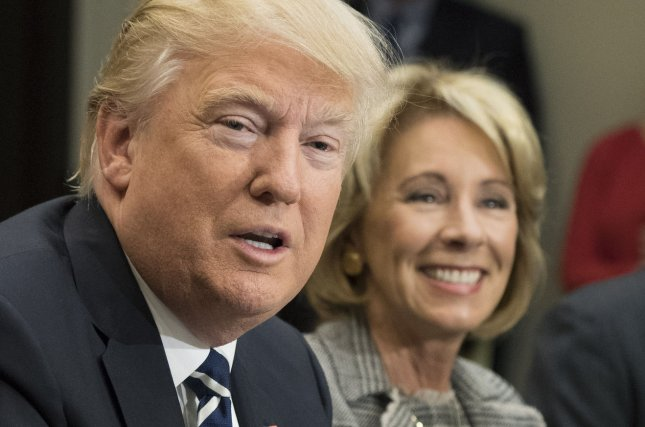 People with connections to the for-profit college industry have joined President Donald Trump's Education Department, led by Education Secretary Betsy DeVos. File Photo by Kevin Dietsch/UPI
