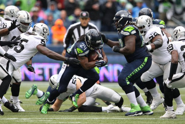Seattle Seahawks running back Marshawn Lynch (24) rushes to a first down against the Oakland Raiders during the second quarter at CenturyLink Field in Seattle, Washington on November 2, 2014. Lynch rushed for 67 yards, caught five passes for 76 yards and scored two touchdown as the Seahawks beat the Raiders 30-24. File photo by Jim Bryant/UPI