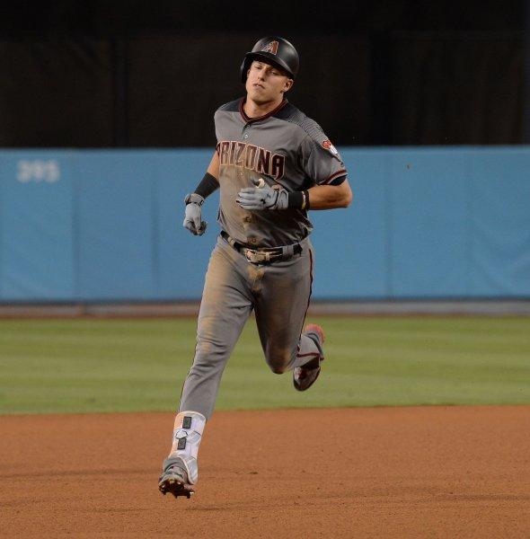 Jake Lamb erupted for six RBIs to lead the Arizona Diamondbacks past the Cincinnati Reds on Thursday. Photo by Jim Ruymen/UPI