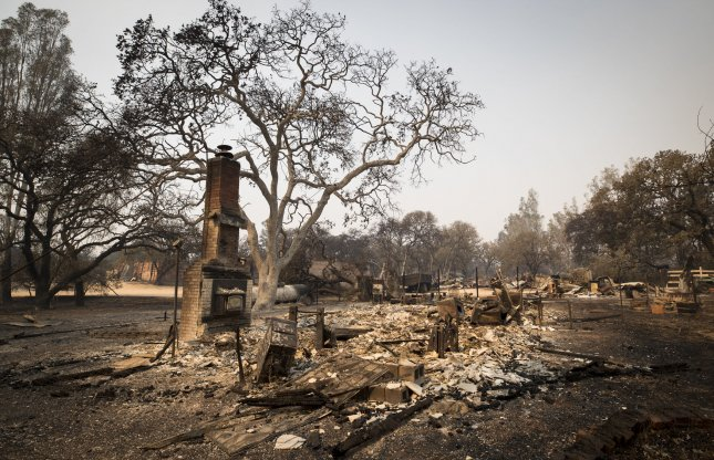 The remains of a home that was devastated by wildfire in Glen Ellen, Calif., on Thursday. The death toll rose to 38 as of Saturday morning and a 4.0-magnitude earthquake struck Mendocino County.